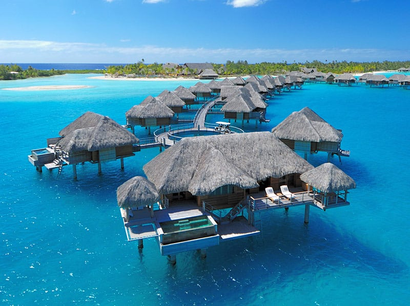 Bora Bora Four Seasons Resort - Luxurious overwater bungalow accommodations surrounded by sand-fringed islets on an outer coral reef that encloses a turquoise lagoon. | boraboraphotos.com