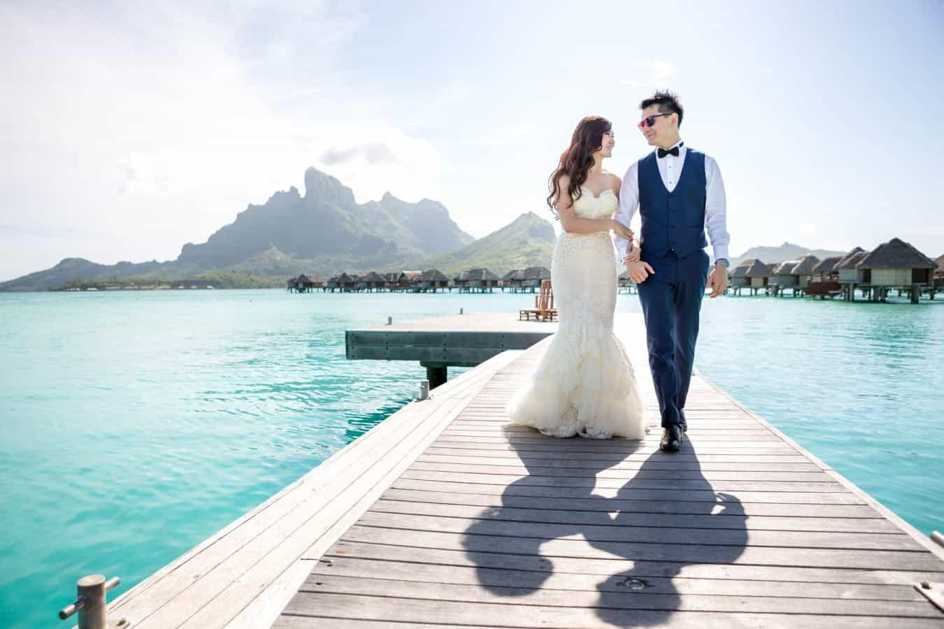 Damien Goburn - Bora Bora Wedding Photographer shooting a happy couple