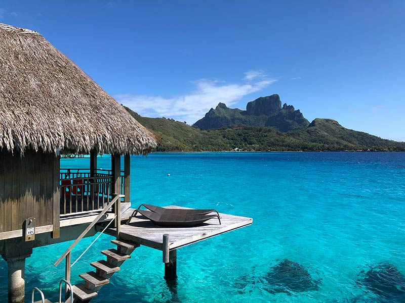 two lounge chairs on an overwater bungalow in Bora Bora